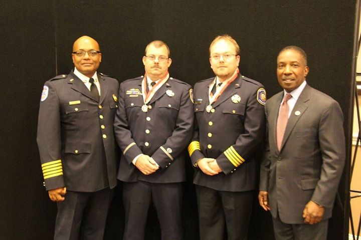 Pictured left to right are Fire Chief/Paramedic John Butler, Lt./Paramedic Will Huber (also received the award), Medical Director Matt Levy, Howard County Chief Administrative Officer Lonnie Robbins