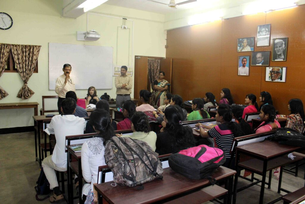Ellen Handler Spitz is introduced to the class at Utkal University by the department chair, Professor Himansu Mohapatra.