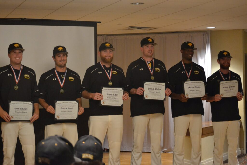 UMBC Baseball team honors graduating seniors on the road. Photo courtesy of UMBC Athletics.