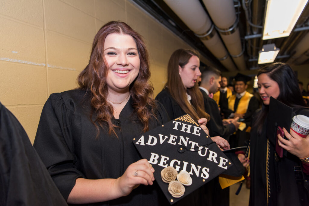 Students get creative with their caps during Winter Commencement.
