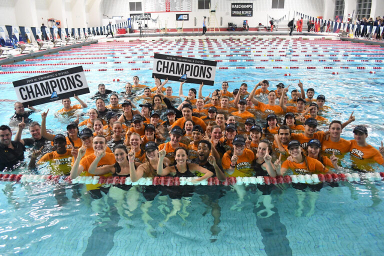 UMBC men's and women's swimming and diving teams celebrate their America East victory. Photo courtesy of Colleen Hummel.