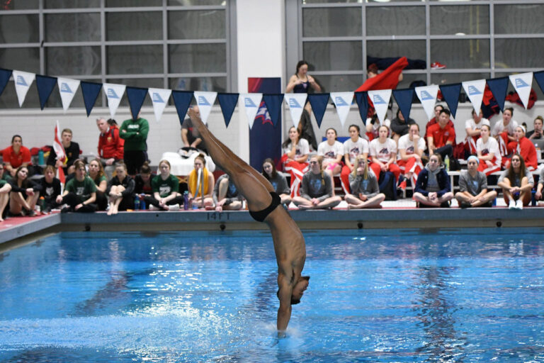 Elijah Wright executes an impressive dive during America East competition. Photo courtesy of Colleen Hummel.