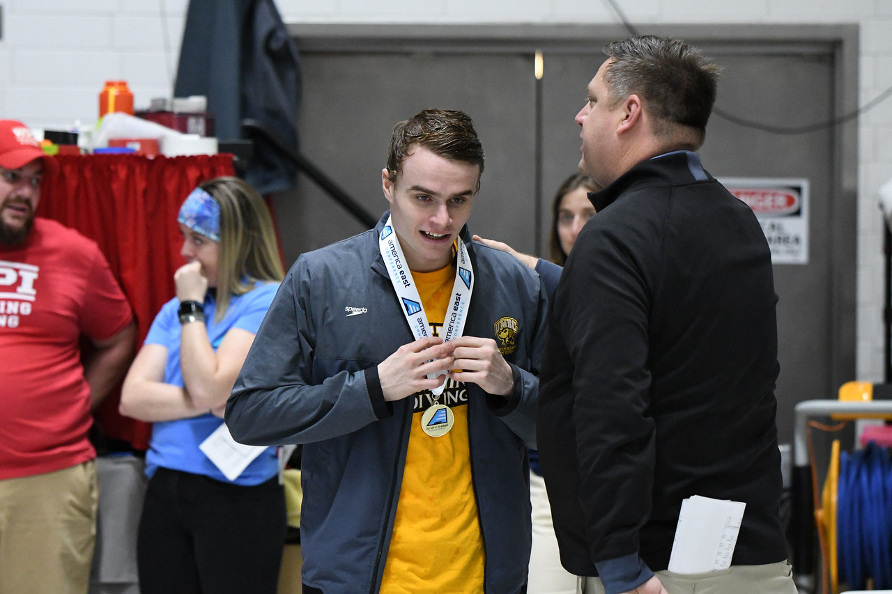 Alexander Gliese medals during day two of America East competition. Photo courtesy of Colleen Hummel.