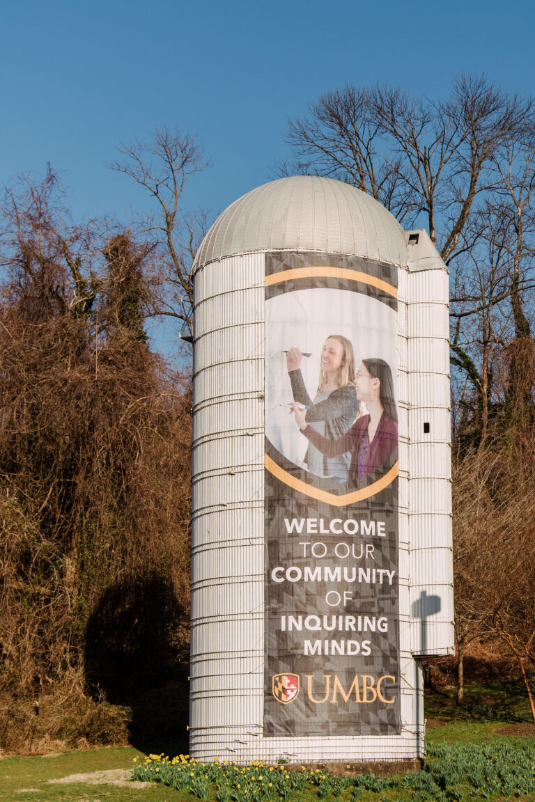 Silo banner at the entrance to UMBC's campus.