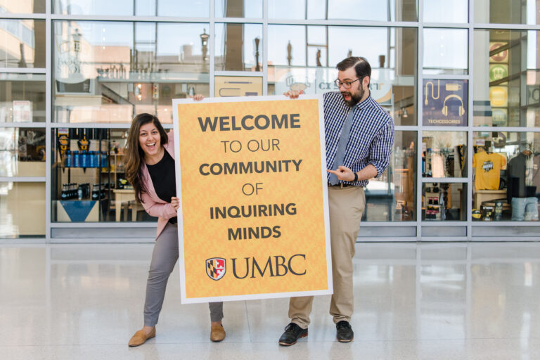 Poulomi Banerjee '16, development and alumni coordinator, and Lubaszewski at UMBC's campus brand launch event.