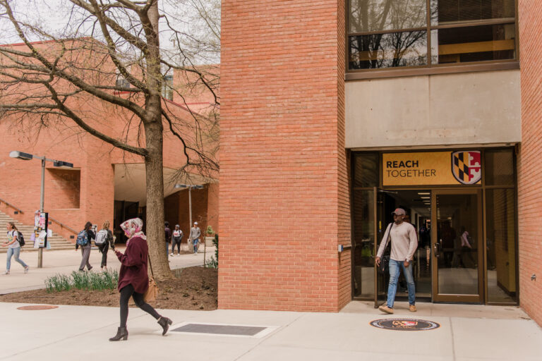 New branded imagery adorns campus doorways.