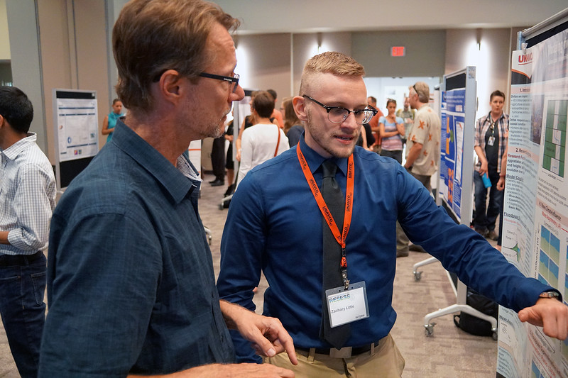 Zachary Little, a 2018 RESESS intern, discusses his summer research with CU Boulder's Greg Tucker. August 2, 2018. Boulder, Colorado. (Photo/Daniel Zietlow, UNAVCO)