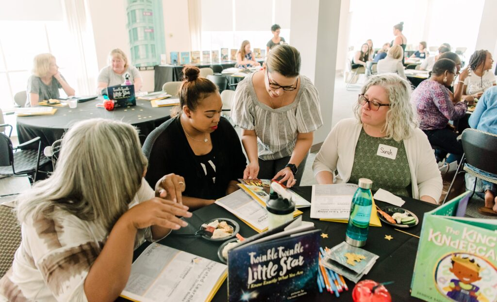 Featured image: Jennifer Mata-McMahon (third from left), associate professor of early childhood education, working with Baltimore City teachers at the Sherman Center for Early Learning in Urban Communities' summer institute.